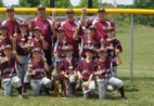 Youth baseball group posing with trophies.