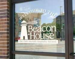 Beacon House logo decal on storefront door window.