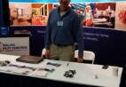 Wil-Kil employee standing at pest convention booth.