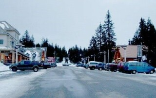 Street view of town during winter snowfall.
