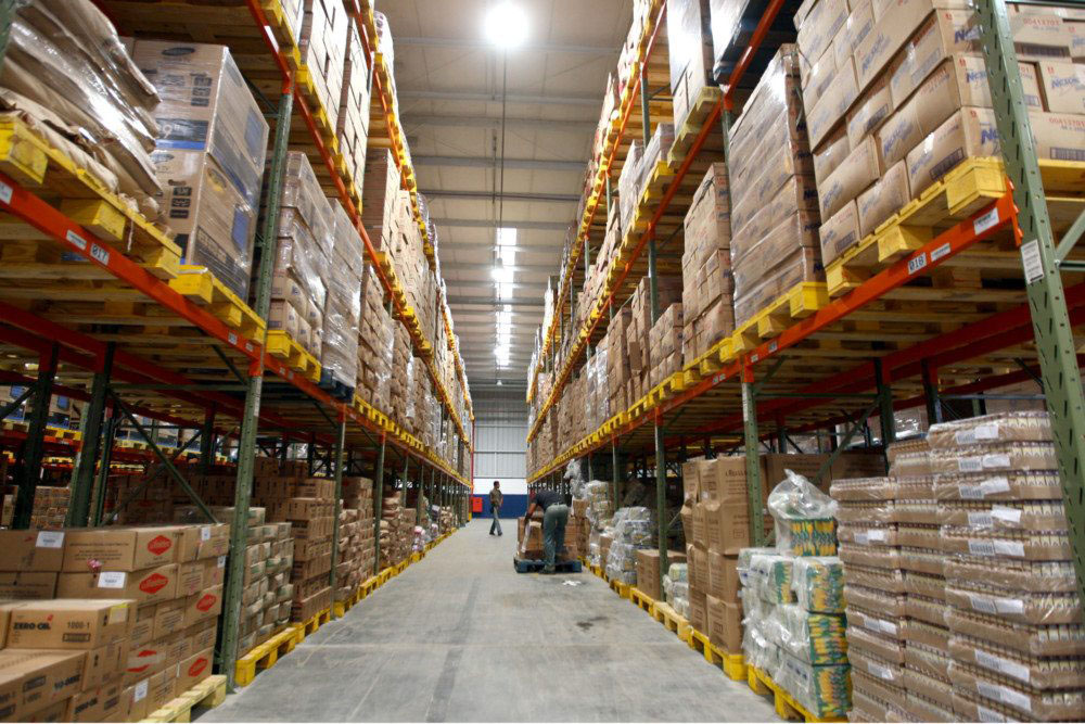 Aisle view of warehouse filled with boxes.
