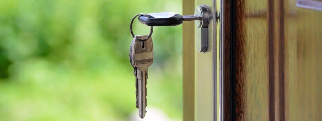 Keys in door lock opening door.