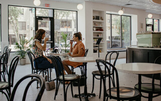 Two women drinking coffee at restaurant